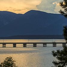 Mountains, lake, and bridge