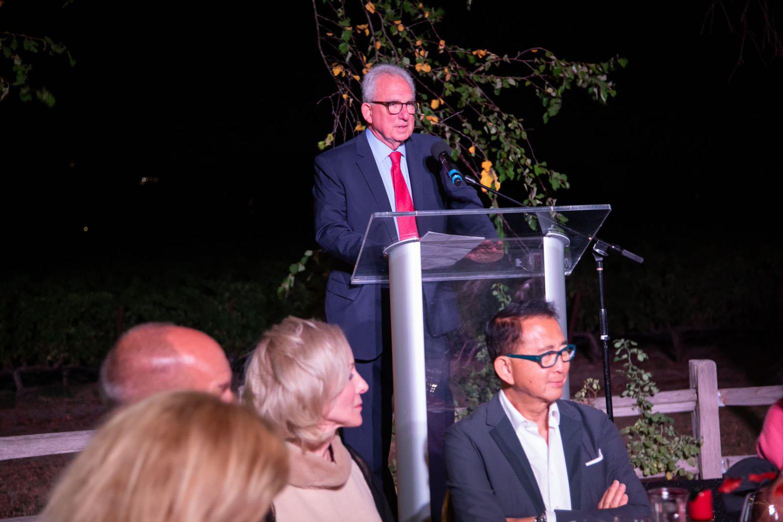 Davis at podium