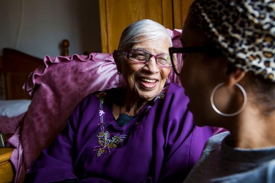 Elderly woman talking to friend