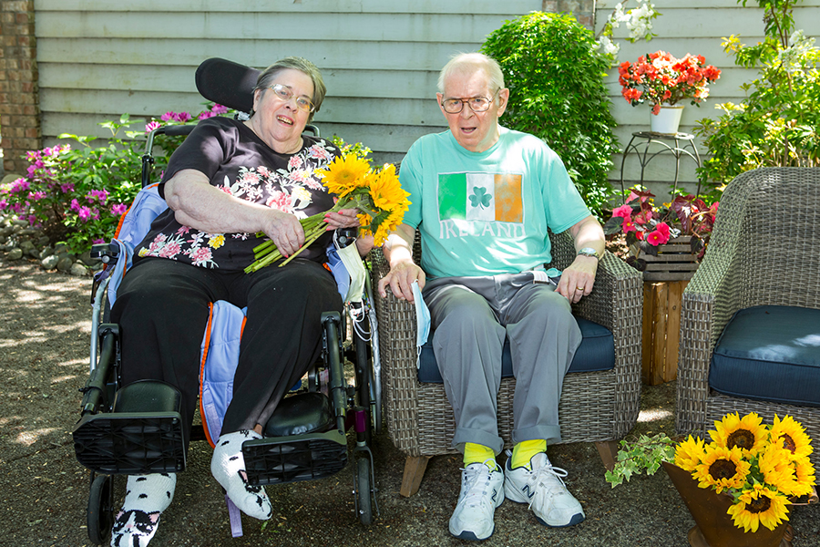 Elderly man and woman in wheelchairs