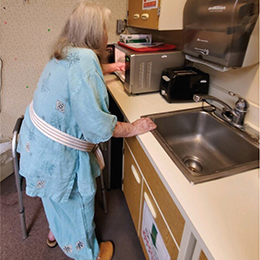 Resident using microwave in TCU Kitchen