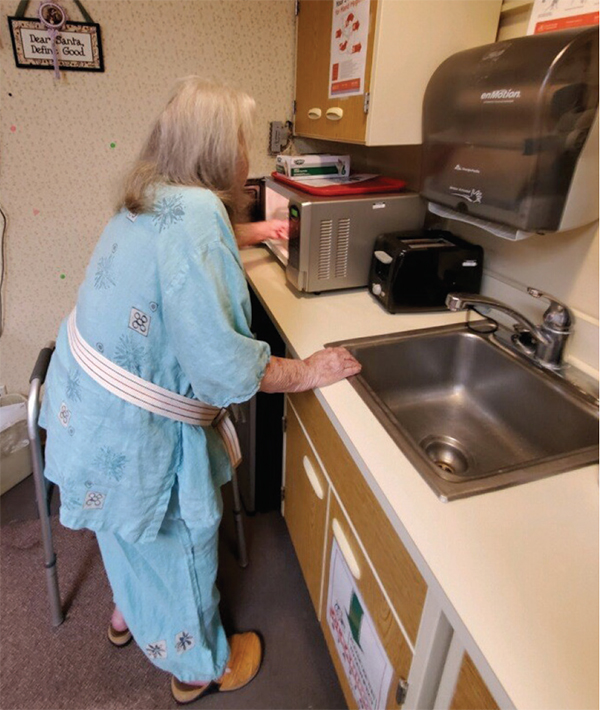 Transitional care patient uses kitchen sink