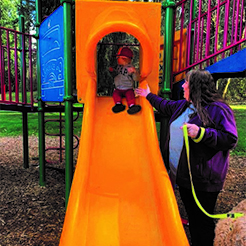 Melissa Hansen help grandson on slide